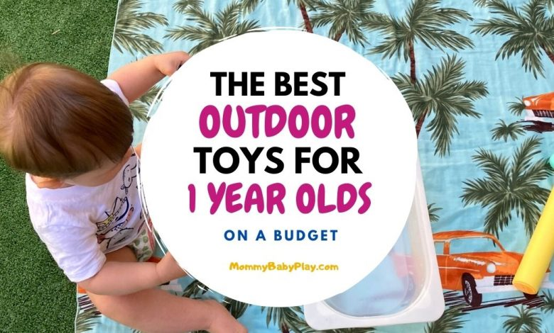 one year old with outdoor toys