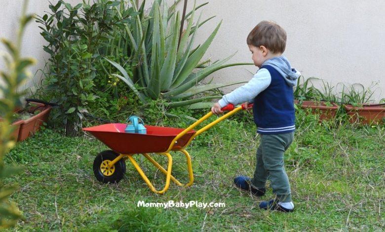 2 year old with a wheelbarrow